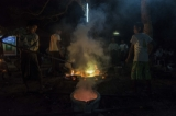 Melted bronze liquid being taken out from the furnace. (Photo - teza hlaing/The Irrawaddy)