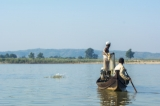 A fisherman waiting for Irrawaddy dolphin to give signal to him. (Photo - teza hlaing/ The Irrawaddy)