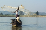 A fisherman spreading out fishing net to where the Irrawaddy dolphin makes signal. (Photo - teza hlaing/ The Irrawaddy)