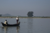 A fishing boat waiting Irrawaddy dolphin gives signal with its tail. (Photo - teza hlaing/ The Irrawaddy)