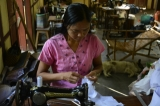 A woman working at tailoring shop funded by Japan as part of rehabilitation of leprosy patients and their families. (Only a few of children born from leprosy patients are infected with leprosy and they can live a normal life.) (Photo - teza hlaing / The Irrawaddy)