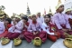 Mon youth association in Rangoon poured water on Boa tree at Shwe Dagon Pagoda on Full Moon Day of Kason, May 2, 2015 and paid obeisance to the pagoda. The association holds the ceremony annually. (Photo: Sai Zaw/The Irrawaddy)