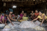 Women prepare freshly caught fish to sell in Andin. (Photo: Tin Htet Paing / The Irrawaddy)