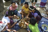 Local men and women prepare food to be shared with other worshippers. (Photo: Teza Hlaing / The Irrawaddy)