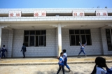 Children walk past a school in Panghsang. (Photo: JPaing / The Irrawaddy)