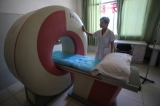A technician shows an MRI machine at a Wa Special Region government-owned hospital in Panghsang. (Photo: JPaing / The Irrawaddy)