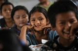 Schoolchildren smile for the camera at a Panghsang school. (Photo: JPaing / The Irrawaddy)