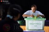 A civil servant casts a ballot at a polling station in Naypyidaw's Zabuthiri Township during a Nov. 8 election. (Photo: J Paing / The Irrawaddy)