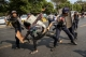 Police attack student protesters in Hledan, Yangon on March 10. (Photo: Thaw Hein Htet / The Irrawaddy)