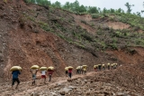Locals carry relief supplies on the Gangaw-Hakha road near Chin State's Lan Thoke village on Aug. 28, after heavy flooding and landslides across the state. (Photo: Sai Zaw / The Irrawaddy)