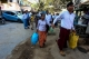 Former political prisoners and their family members carry luggage outside of Rangoon's Insein Prison following their release on Friday. In Yangon, Jaunary 22. Photo: Pyay Kyaw / The Irrawaddy