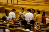 The last day of the final session of Burma's bicameral parliament began on Friday with lawmakers appearing more relaxed than on past days during the legislature's five-year term. With no more serious debates or discussions, the atmosphere in the chamber seemed more like the last day of a high school farewell party, with lawmakers taking group pictures and bidding farewell to colleagues.