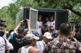 Police forcibly detain labor rights protestors in Tatkon Township on May 18, 2016. ( Photo - Thiha Lwin / The Irrawaddy )