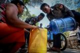Ahlon Township Police Force donated drinking water to Kyaung Waing Gyi Village in Ton Tay Township on May 15, 2016. (Photo: Pyay Kyaw/The Irrawaddy)