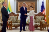 U.S. Secretary of State John Kerry, accompanied by U.S. Ambassador to Myanmar Scot Marciel, shakes hands with Myanmar Foreign Minister Aung San Suu Kyi before a bilateral meeting on May 22, 2016, at the Ministry of Foreign Affairs in Naypyitaw, Myanmar. [State Department photo/ Public Domain]
