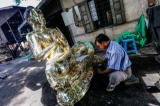 Man making bronze Buddha in Mandalay on June 6, 2016. ( Photo - Zaw Zaw / The Irrawaddy)