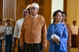 Aung San Suu Kyi, right, and President Htin Kyaw enter Parliament in March 2016. (Photo - JPaing/ The Irrawaddy)