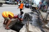 YCDC workers clean a street in downtown Rangoon on June 13,2016 . (Photo - Myo Min Soe / The Irrawaddy)