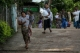 Muslim residents of Thuye Thamain village flee to the police station in the village at 4 p.m. local time on June 24, 2016.(Photos: Hein Htet / The Irrawaddy)