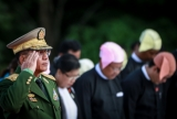 Myanmar Commander in Chief Senior General Min Aung Hlaing salutes as he attends an event marking the anniversary of Martyrs' Day at the Martyrs' Mausoleum in Yangoon on July 19, 2016. (Photo - Hein Htet)