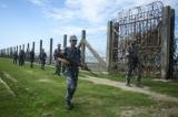 Border Guard Police patrol in northern Arakan State.