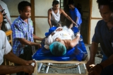 Kan Thar Yar village live Thein Htun, 23-year-old Buddhist Rakhine teacher, recovers from a gunshot wound in the abdomen at a hospital in Maung Daw located in Rakhine State on October 15, 2016 after he was shot by unknown gunmen.