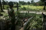 Myanmar soldier a machine gun post near the Border Guard Police headquarters in the Kyinkanpyin area of Maungdaw township, in Rakhine State on Oct17, 2016.