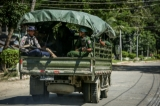 Armed military and police force travel in trucks through Maungdaw, located in Rakhine State, on Oct 17, 2016.