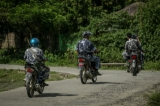 Myanmar border police on motorcycles approaching the Border Guard Police headquarters in the Kyinkanpyin area of Maungdaw township, in Rakhine State on Oct 17, 2016.