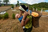 A local mother and her child walk through the village. (Photo: Pyay Kyaw / The Irrawaddy)