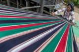 A woman in Siangsawn works on weaving traditional textiles. (Photo: Pyay Kyaw / The Irrawaddy)