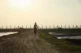 A Muslim(Rohingya) man walk near the border of Myanmar and Bangladesh in Maungdaw, Rakhine state on Oct 18, 2016.