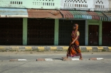 A Women walk in front of closed shops in the town centre of Maungdaw, after attacks on police posts over a week ago located Rakhine on Oct 17, 2016. (Hein Htet/The Irrawaddy)