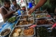 Two men eat street food for lunch in downtown Rangoon on photo: J Paing / The Irrawaddy)