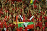 Myanmar football fans cheer during the AFF Suzuki Cup Group B soccer match in Thuwanna Football statdium in Yangon, Myanmar, November 23, 2016. Hein Htet/The Irrawaddy