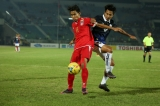 Myanmar player in action against Cambodia player during the AFF Suzuki Cup Group B soccer match in Thuwanna Football statdium in Yangon, Myanmar, November 23, 2016. Hein Htet/The Irrawaddy