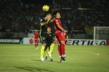 Malaysia player in action against Myanmar player during the AFF Suzuki Cup Group B soccer match in Thuwanna Football statdium in Yangon, Myanmar, November 26, 2016. Hein Htet/The Irrawaddy