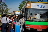 As Monday, Jan. 16 marks the first day of Yangon Bus Service operations, commuters wait to board the new downtown bus line in the transit area near Thakhin Mya Park. (Photos: Pyay Kyaw / The Irrawaddy)