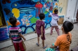 Artists and local children painted a mural behind 27th Street lower block in Rangoon on Saturday as part of the alley garden project. The alley garden project is headed by Doh Eain & Yangon City Grower and aims to convert the city's wasteland into community gardens for recreation, food production, and social projects. The group recently converted about one eighth of the 27th Street alley into a garden and plan to transform the entire block by mid 2017. The event—part of the Yangon Art Heritage Festival—will continue on Sunday between 10am and 2pm at No. 79, 27th Street lower block, near the corner with Mahabandoola Road.     PHOTO - NAING LIN SOE / THE IRRAWADDY