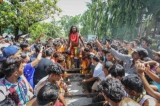 IN PICTURES: Worshipers walked on fire at a Hindu temple in Mandalay's Aungmyaythazan Township on Sunday. Fire-walking over a bed of hot ash and coals and having Hindu priests pierce tongues, cheeks and bodies of devotees are seen as signs of devotion and self-sacrifice, according to Hindu tradition. (Photos: Zaw Zaw/ The Irrawaddy)