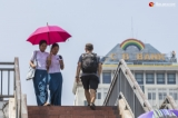 People walk around downtown under the scorching sun of summer on April 25, 2019.  Photo - Htet Wai/ Irrawaddy
