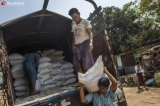 Workers unload the rice bags from the truck at Mawtin rice warehouse on March 25, 2020.  Photo - Htet Wai/ Irrawaddy  Photo - Htet Wai/ Irrawaddy