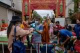 Covid-19 affected Burmese migrants come to receive food handouts organized by the multi-ethnic brotherhood lead by Johny Adhikari at Wat Sai Moon Temple, a Burmese temple built during the time that Chiangmai was under Burmese rule. - Chiang Mai, Thailand in April 2020.