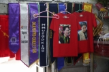 T-shirts with Daw Aung San Suu Kyi's picture hang at a fabric printing shop in Shwegondine. / Myo Min Soe / The Irrawaddy 18.8.20